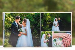 Open pages of brown luxury leather wedding book or album royalty free stock photography