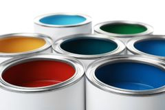 Open paint cans, closeup view. Professional material stock photo