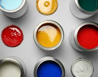 Open paint cans on grey, top view. Open paint cans on grey background, top view stock images