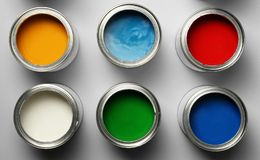Open paint cans on grey background. Top view royalty free stock images