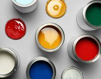 Open paint cans on grey, top view. Open paint cans on grey background, top view royalty free stock photos
