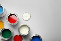 Open paint cans and space for text on grey background. Top view stock photo