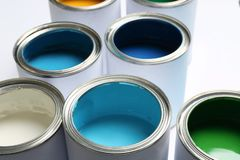 Open paint cans on white background. Closeup royalty free stock photo