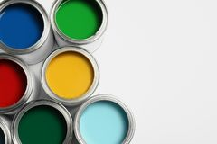 Open paint cans on white, top view. Space for text. Open paint cans on white background, top view. Space for text royalty free stock photography