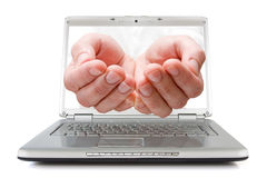 Open palms coming out of a laptop Royalty Free Stock Photo