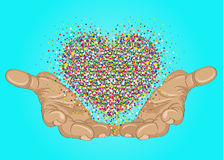 From open palms fly multi-colored confetti in the form of heart. Royalty Free Stock Images