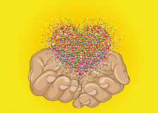 From open palms fly multi-colored confetti in the form of heart. Royalty Free Stock Photos