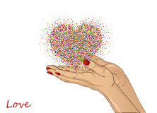 From open palms fly multi-colored confetti in the form of heart. Stock Photo