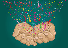 From the open palms of hands fly multicolored confetti. Greeting card Royalty Free Stock Images
