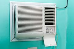 Open panel adjustment of a small room air conditioner. Open panel adjustment of a small room air conditioner stock photo