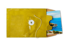 Open paper envelope with holiday postcard inside Royalty Free Stock Photo