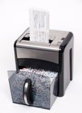 Open paper shredder. A paper shredder with a confidential document about to be shredded Royalty Free Stock Photography