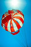 Open parachute in the blue sky Royalty Free Stock Image