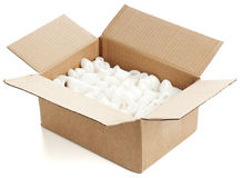 Open parcel filled with plastic chips Royalty Free Stock Image