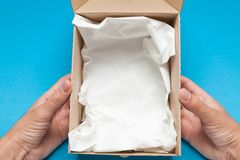 Open parcel postal package, free shipping stock photo