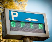 Open... parking  sign in front a parking lot Royalty Free Stock Photography