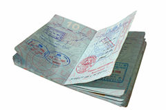 Open Passport With Asian Visas. An open United States passport in isolation with pages covered in stamps from Asian and southeast Asian Countries royalty free stock photo