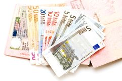 Open passport with money stock photo
