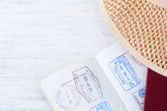 Open passport with visa stamps and hat. Stock Images