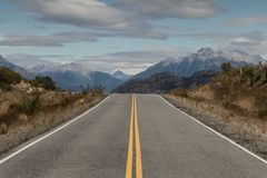 Open Paved Road Through Mountains, Patagonia, Argentina. Open paved road through mountain in Patagonia, Argentina Royalty Free Stock Photos