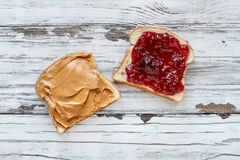 Open Peanut Butter and Strawberry Jelly Sandwich royalty free stock photo