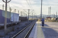 Open perspective shot of farmer at railway station stock photo