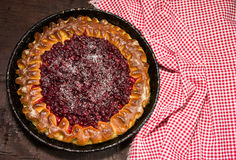 Open pie with cowberries Stock Photography