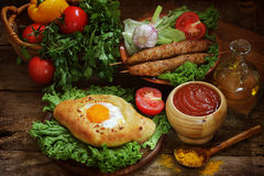 Open pie with egg, barbecue cutlets submitted with tomato sauce, Stock Photos