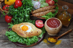 Open pie with egg and cutlets on a skewer submitted with sauce  Stock Photos