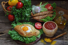 Open pie with egg and cutlets on a skewer submitted with sauce Stock Photography