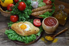 Open pie with egg and cutlets on a skewer submitted with sauce  Royalty Free Stock Photos
