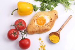 Open pie with egg, tomatoes, pepper and a coriander on a white b. Ackground stock photos