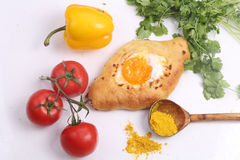 Open pie with egg, tomatoes, pepper and a coriander on a white b. Ackground stock photography