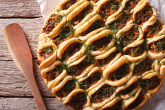 Open pie with meat and vegetables macro. horizontal top view Stock Images