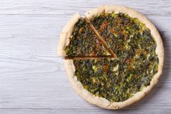 Open pies with herbs, cheese and spinach  top view Royalty Free Stock Photos