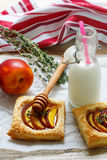 Open pies of puff pastry with peach (nectarine), thyme and honey. Breakfast Royalty Free Stock Image