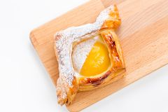 Open pies of puff pastry with peach, thyme and honey. Breakfast. Selective focus Stock Photo