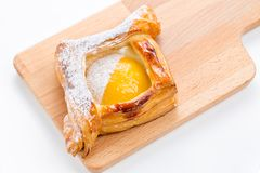 Open pies of puff pastry with peach, thyme and honey. Breakfast. Selective focus Stock Image