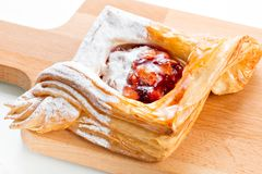 Open pies of puff pastry pies with cranberries, apples and honey. Stock Photography