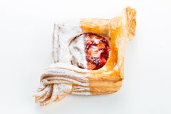 Open pies of Puff pastry pies with cranberries, apples and honey. Royalty Free Stock Image