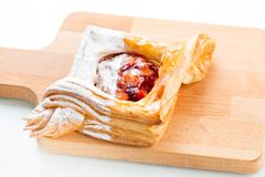 Open pies of puff pastry pies with cranberries, apples and honey. Stock Images