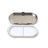 Open Pill Box. Silver and white antique pill box Stock Photography