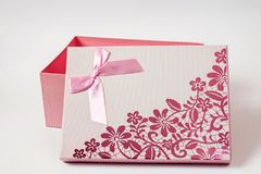 Open pink gift box with ribbon bow, isolated on white.  Stock Photography