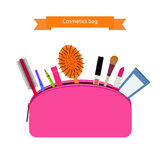 Open pink handbag for cosmetics. Mascara, lipstick, creams and other make-up accessories Royalty Free Stock Photography