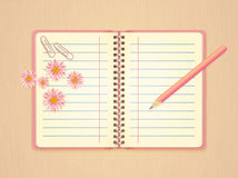 Open pink notebook, flowers, paperclip and pencil Stock Photography