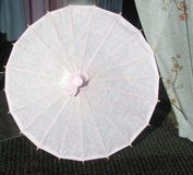 Open pink paper umbrella Royalty Free Stock Photography