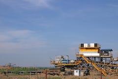Open pit coal mine with excavators Stock Photos