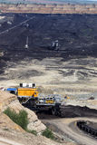 Open pit coal mine with machinery Stock Image