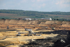 Open pit coal mine with machinery Stock Images