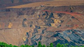 Open pit coal mining, Sangatta, Indonesia. Open pit coal mining activity in Sangatta, Indonesia. huge trucks are used to transport materials in this site Stock Photos